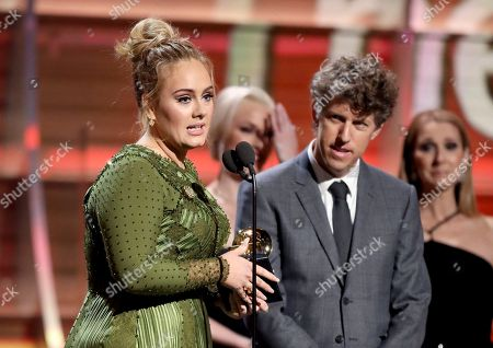 """Adele, left, and Greg Kurstin accept the award for song of the year for """"Hello"""" at the 59th annual Grammy Awards, in Los Angeles"""