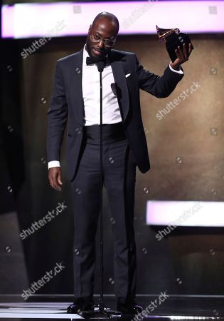 """Paul Jefferies accepts the award for best rap song for """"Hotline Bling"""" at the 59th annual Grammy Awards, in Los Angeles"""
