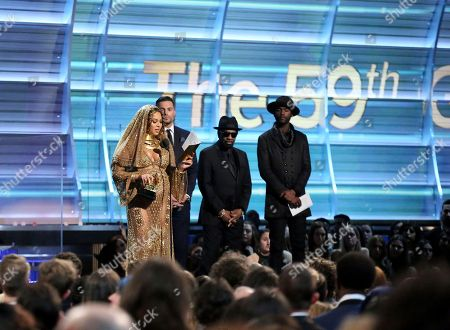 "Beyonce accepts the award for best urban contemporary album for ""Lemonade"" at the 59th annual Grammy Awards, in Los Angeles. William Bell, and Gary Clark Jr. look on from right"
