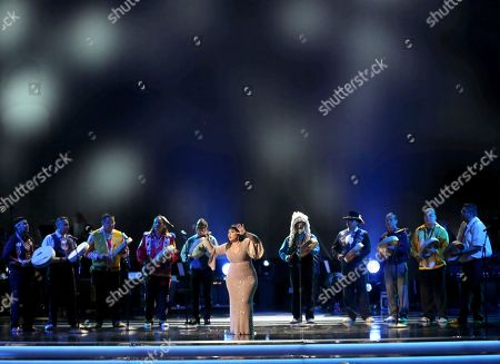 Carla Morrison, center, and Northern Cree perform at the 59th annual Grammy Awards, in Los Angeles