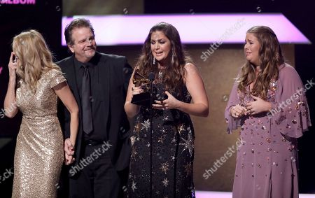 """Linda Davis, from left, Lang Scott, Hillary Scott, and Rylee Scott accept the award for best contemporary christian music performance/song for """"Thy Will"""" at the 59th annual Grammy Awards, in Los Angeles"""