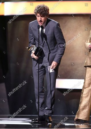 Greg Kurstin accepts the award for producer of the year, non-classical at the 59th annual Grammy Awards, in Los Angeles