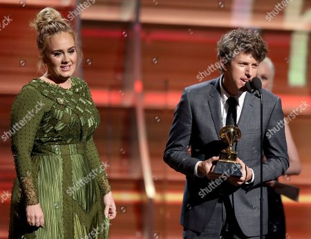 """Greg Kurstin, right, and Adele accept the award for song of the year for """"Hello"""" at the 59th annual Grammy Awards, in Los Angeles"""