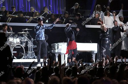 Chance the Rapper, from left, Kirk Franklin, and Tamela Mann perform at the 59th annual Grammy Awards, in Los Angeles