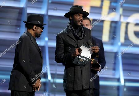 William Bell, left, and Gary Clark Jr. present the award for best urban contemporary album at the 59th annual Grammy Awards, in Los Angeles