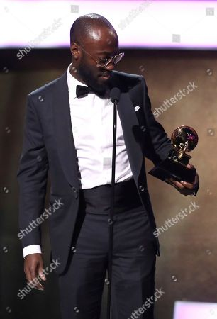 """Stock Picture of Paul Jefferies accepts the award for best rap song for """"Hotline Bling"""" at the 59th annual Grammy Awards, in Los Angeles"""