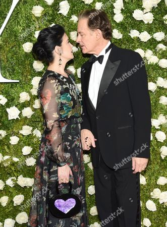 Phoebe Cates, left, and Kevin Kline kiss as they arrive at the 71st annual Tony Awards at Radio City Music Hall, in New York