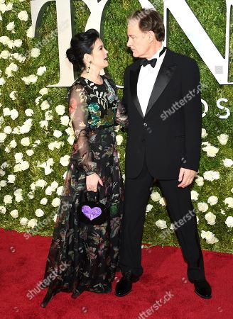 Phoebe Cates, left, and Kevin Kline arrive at the 71st annual Tony Awards at Radio City Music Hall, in New York