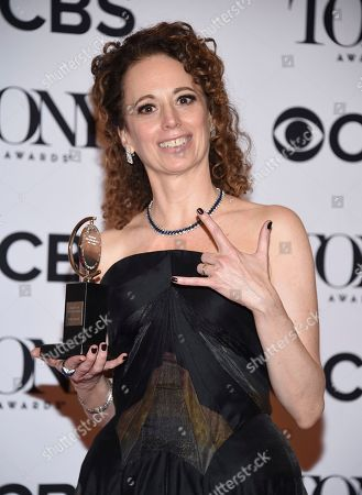 "Rebecca Taichman poses in the press room with the award for best direction of a play for ""Indecent"" at the 71st annual Tony Awards, in New York"