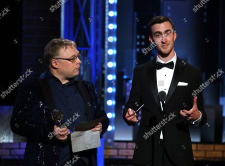Stock Photo of Gareth Fry, left, and Pete Malkin, accept the special Tony award for sound design at the 71st annual Tony Awards, in New York