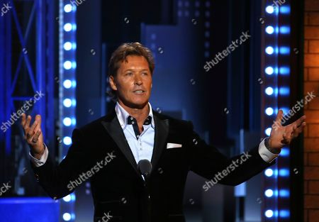"Former New York Ranger Ron Duguay introduces a performance by the cast of ""Come From Away"" at the 71st annual Tony Awards, in New York"