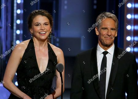 Sutton Foster, left, and Scott Bakula present the award for best performance by an actor in a featured role in a musical at the 71st annual Tony Awards, in New York