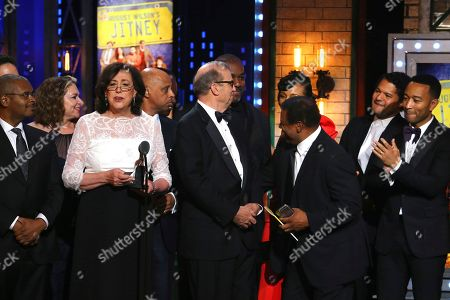 """Lynne Meadow and the cast and crew of """"August Wilson's Jitney"""" accept the award for best revival of a play at the 71st annual Tony Awards, in New York"""