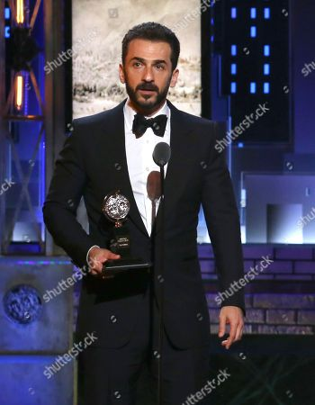 """Michael Aronov accepts the award for best performance by an actor in a featured role in a play for """"Oslo"""" at the 71st annual Tony Awards, in New York"""