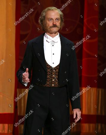 """David Hyde Pierce performs with the cast of """"Hello Dolly!"""" at the 71st annual Tony Awards, in New York"""