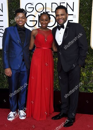 Anthony Anderson, right, Kyra Anderson, center, and Nathan Anderson arrive at the 74th annual Golden Globe Awards at the Beverly Hilton Hotel, in Beverly Hills, Calif
