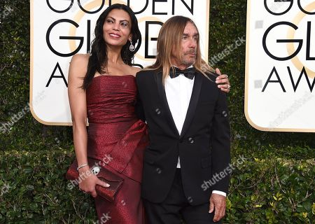 Nina Alu, left, and Iggy Pop arrive at the 74th annual Golden Globe Awards at the Beverly Hilton Hotel, in Beverly Hills, Calif