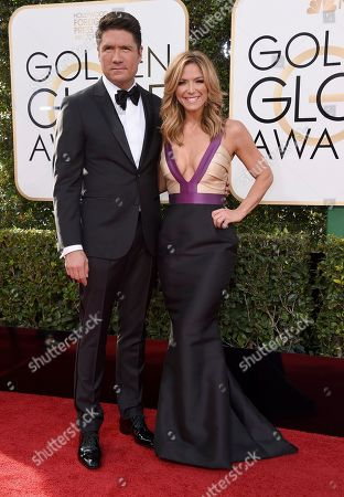 Louis Aguirre, left, and Debbie Matenopoulos arrive at the 74th annual Golden Globe Awards at the Beverly Hilton Hotel, in Beverly Hills, Calif