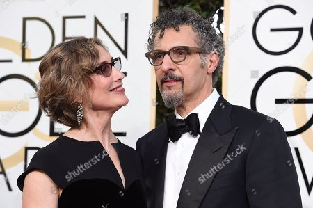 Stock Photo of Katherine Borowitz, left, and John Turturro arrive at the 74th annual Golden Globe Awards at the Beverly Hilton Hotel, in Beverly Hills, Calif