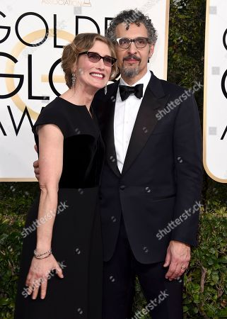 Katherine Borowitz, left, and John Turturro arrive at the 74th annual Golden Globe Awards at the Beverly Hilton Hotel, in Beverly Hills, Calif
