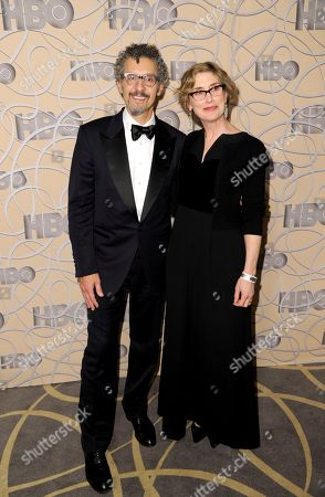 Stock Picture of John Turturro, left, and Katherine Borowitz arrive at the HBO Golden Globes afterparty at the Beverly Hilton Hotel, in Beverly Hills, Calif