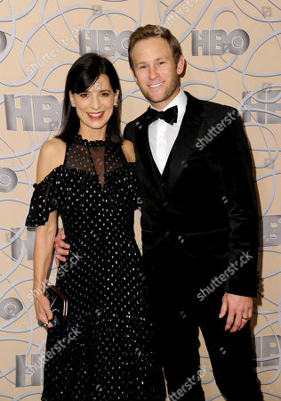 Perrey Reeves, left, and Aaron Endress-Fox arrive at the HBO Golden Globes afterparty at the Beverly Hilton Hotel, in Beverly Hills, Calif