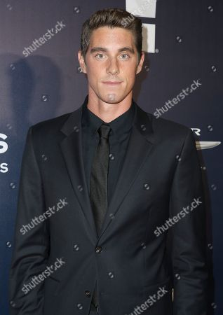 Conor Dwyer arrives at the NBCUniversal Golden Globes afterparty at the Beverly Hilton Hotel, in Beverly Hills, Calif