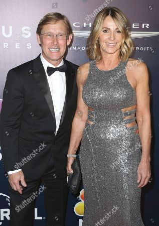 Bart Conner, left, and Nadia Comaneci arrive at the NBCUniversal Golden Globes afterparty at the Beverly Hilton Hotel, in Beverly Hills, Calif