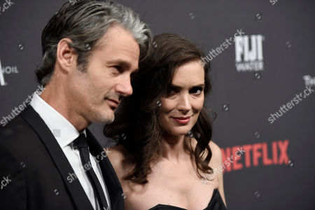 Scott Mackinlay Hahn, left, and Winona Ryder arrive at The Weinstein Company and Netflix Golden Globes afterparty at the Beverly Hilton Hotel, in Beverly Hills, Calif