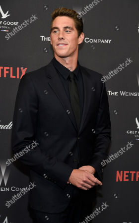 Conor Dwyer arrives at The Weinstein Company and Netflix Golden Globes afterparty at the Beverly Hilton Hotel, in Beverly Hills, Calif