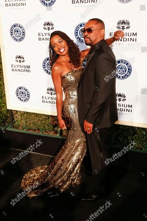 Stock Photo of Daren Dukes, right, and Shanola Hampton arrive at The Art of Elysium's 10th Annual Heaven Gala at Red Studios, in Los Angeles