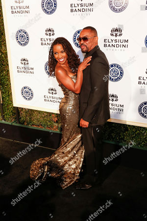 Daren Dukes, right, and Shanola Hampton arrive at The Art of Elysium's 10th Annual Heaven Gala at Red Studios, in Los Angeles