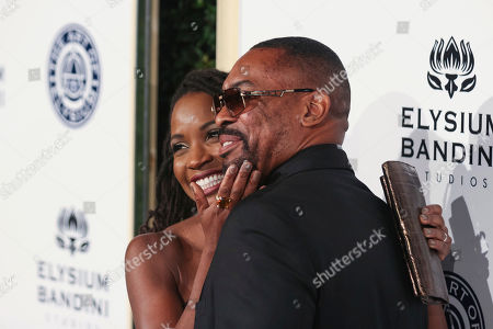 Stock Image of Daren Dukes, right, and Shanola Hampton arrive at The Art of Elysium's 10th Annual Heaven Gala at Red Studios, in Los Angeles