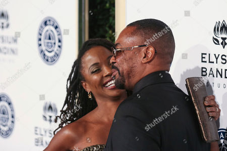 Stock Picture of Daren Dukes, right, and Shanola Hampton arrive at The Art of Elysium's 10th Annual Heaven Gala at Red Studios, in Los Angeles