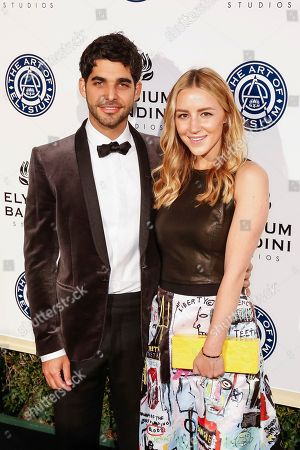 Freddy Wexler, left, and Olivia Zaro arrive at The Art of Elysium's 10th Annual Heaven Gala at Red Studios, in Los Angeles