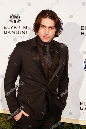 Logan Huffman arrives at The Art of Elysium's 10th Annual Heaven Gala at Red Studios, in Los Angeles