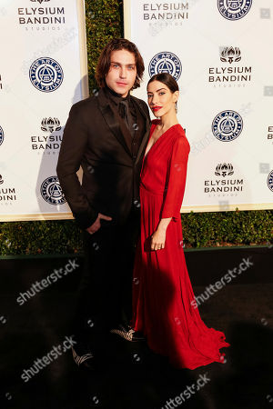 Stock Image of Logan Huffman, left, and Lisa Origliasso arrive at The Art of Elysium's 10th Annual Heaven Gala at Red Studios, in Los Angeles