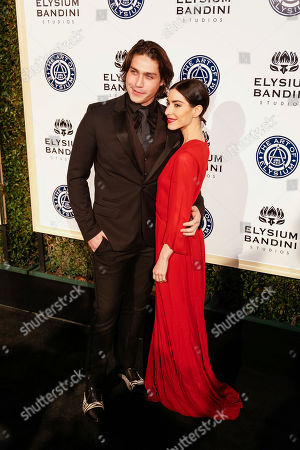 Logan Huffman, left, and Lisa Origliasso arrive at The Art of Elysium's 10th Annual Heaven Gala at Red Studios, in Los Angeles