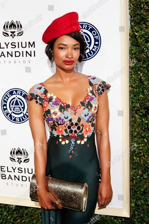 Stock Picture of Angelique Cinelu arrives at The Art of Elysium's 10th Annual Heaven Gala at Red Studios, in Los Angeles