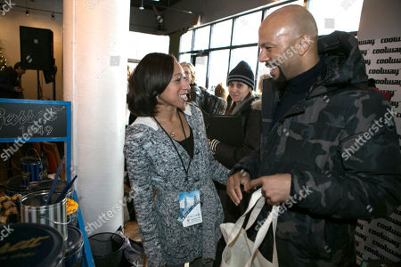 Garret Popcorn representative Crystal Allen, left, chats with rapper, actor and producer Common, right, during his visit to the Music Lodge at the Sundance Film Festival, in Park City, Utah