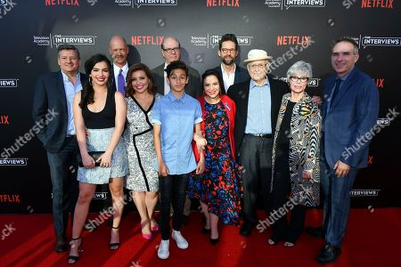 Ted Sarandos, from left, Isabella Gomez, Mike Royce, Justina Machado, Stephen Tobolowsky, Marcel Ruiz, Todd Grinnell, Gloria Calderon Kellett, Norman Lear, Rita Moreno and Michael Schneider attend The Power of TV: A Conversation with Norman Lear and One Day at a Time, presented by the Television Academy Foundation and Netflix in celebration of the Foundation's 20th Anniversary of THE INTERVIEWS: An Oral History Project, on in the Wolf Theatre at the Saban Media Center in North Hollywood, Calif