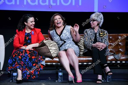 Gloria Calderon Kellett, from left, Justina Machado and Rita Moreno take part in The Power of TV: A Conversation with Norman Lear and One Day at a Time, presented by the Television Academy Foundation and Netflix in celebration of the Foundation's 20th Anniversary of THE INTERVIEWS: An Oral History Project, on in the Wolf Theatre at the Saban Media Center in North Hollywood, Calif