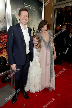 """Director/Writer/Producer Paul W. S. Anderson, Ever Gabo Anderson and Milla Jovovich seen at The World Premiere of Screen Gems' """"Resident Evil: The Final Chapter"""" at Regal LA Live, in Los Angeles"""