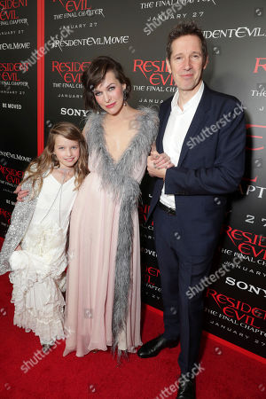 """Ever Gabo Anderson, Milla Jovovich and Director/Writer/Producer Paul W. S. Anderson seen at The World Premiere of Screen Gems' """"Resident Evil: The Final Chapter"""" at Regal LA Live, in Los Angeles"""