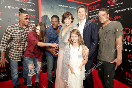 """Stock Photo of Milla Jovovich, Ever Gabo Anderson and Director/Writer/Producer Paul W. S. Anderson seen at The World Premiere of Screen Gems' """"Resident Evil: The Final Chapter"""" at Regal LA Live, in Los Angeles"""