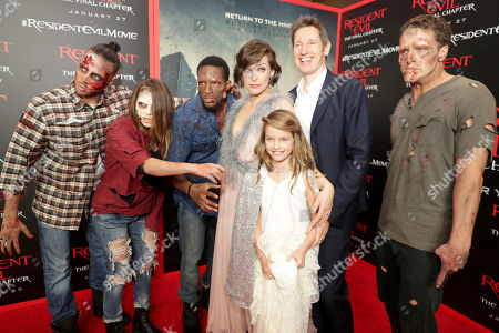 """Milla Jovovich, Ever Gabo Anderson and Director/Writer/Producer Paul W. S. Anderson seen at The World Premiere of Screen Gems' """"Resident Evil: The Final Chapter"""" at Regal LA Live, in Los Angeles"""