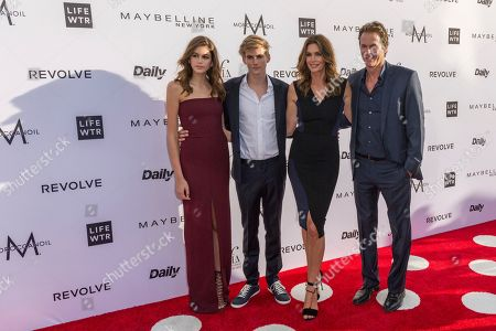 Kaia Jorden Gerber, from left, Presley Walker Gerber, Cindy Crawford, and Rande Gerber arrive at the Third Annual Fashion Los Angeles Awards at the Sunset Tower Hotel, in West Hollywood, Calif