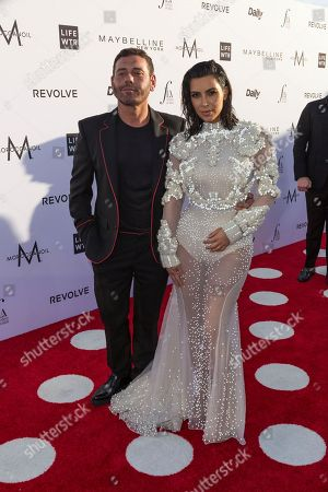 Mert Alas, left, and Kim Kardashian West arrive at the Third Annual Fashion Los Angeles Awards at the Sunset Tower Hotel, in West Hollywood, Calif