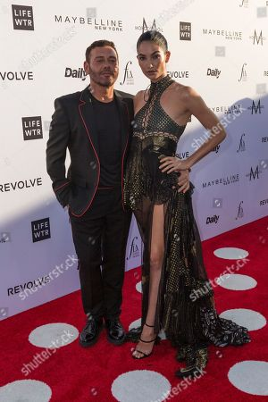 Mert Alas, left, and Lily Aldridge arrive at the Third Annual Fashion Los Angeles Awards at the Sunset Tower Hotel, in West Hollywood, Calif