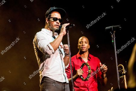 Amos Lee, left, performs with Trombone Shorty of Trombone Shorty and Orleans Avenue at the Saenger Theatre, in New Orleans